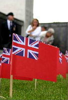 small red ensign planted in lawn